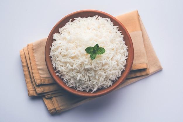 Cooked plain white basmati rice in terracotta bowl