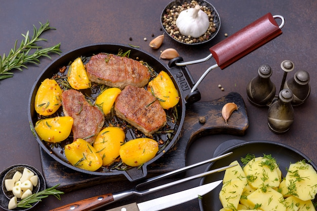 Cooked pork with peach in fry pan