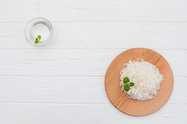 Cooked rice on board with water