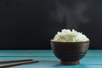 Cooked rice in wooden bowl