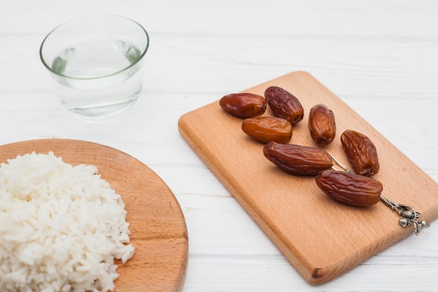 Cooked rice with dates fruit on board