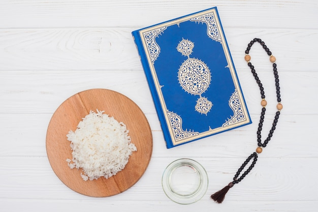 Cooked rice with quran and beads
