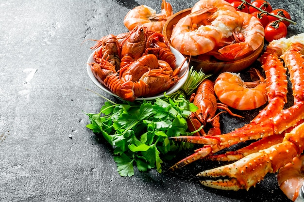 Cooked shrimp, crayfish and crab with parsley.