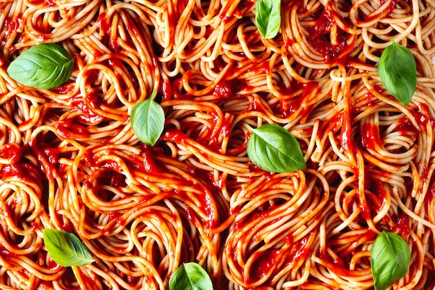 Cooked spaghetti with tomato sauce. background of pasta close up.  top view