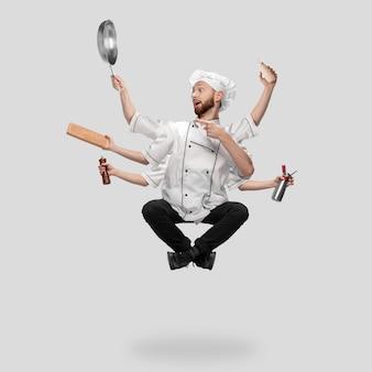 灰色のスタジオの背景に分離されたシヴァのような均一なマルチタスクの炊飯器