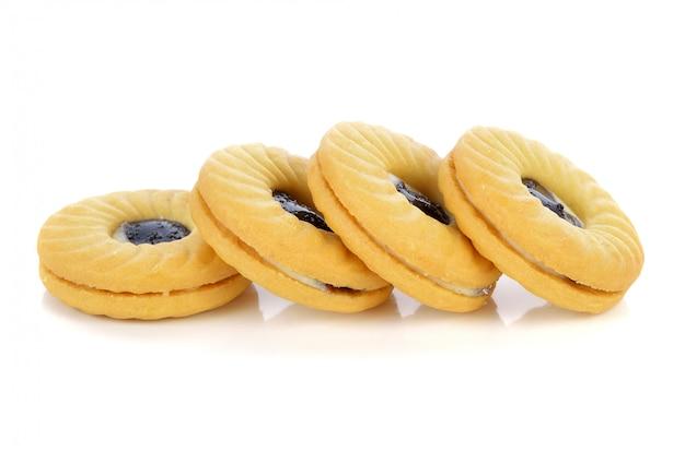 白で隔離されるクッキー