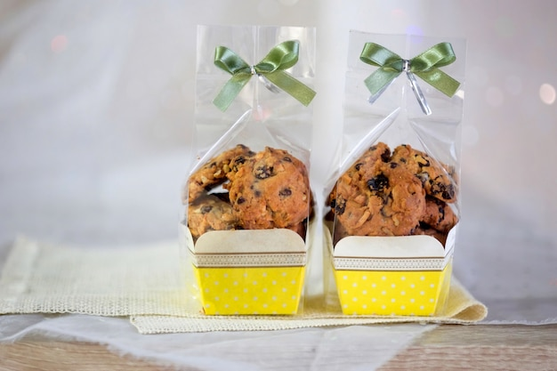 Cookie in paper cup with ribbon bow tie,cookie packaging,chocolate chip cookies.