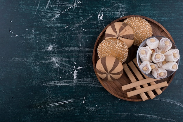 Cookie plate with buns, lokum and waffle sticks ,top view