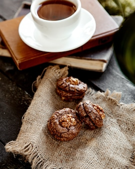Cookie with walnut and  a cup of coffee