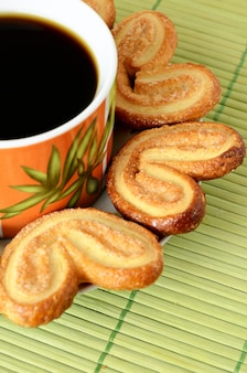 Cookies around a cup of coffee