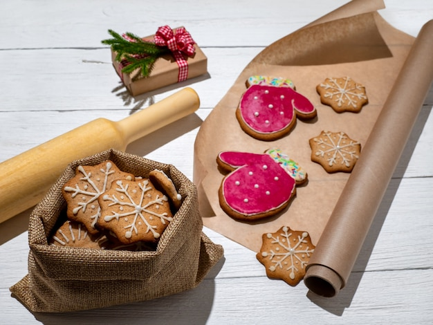 Cookies in bag and on parchment paper preparation of christmas cookies of different shapes new year