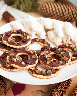 Cookies chocolate sable and kifli in a new year or christmas decoration. rustic style