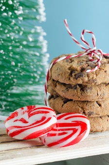 Cookies and christmas candy with christmas tree