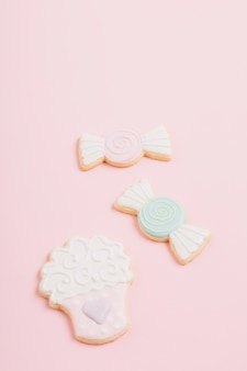 Cookies of different shape on pink background