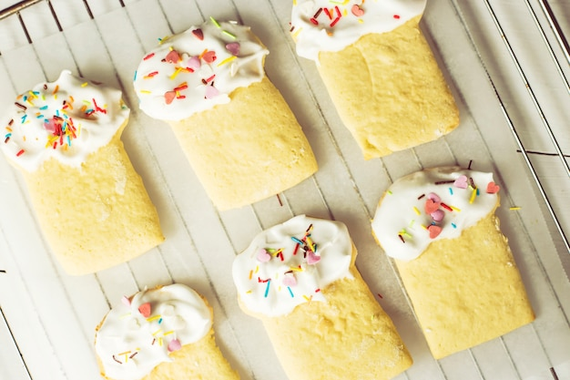 Cookies in the form of easter cakes, decorated with whipped whites