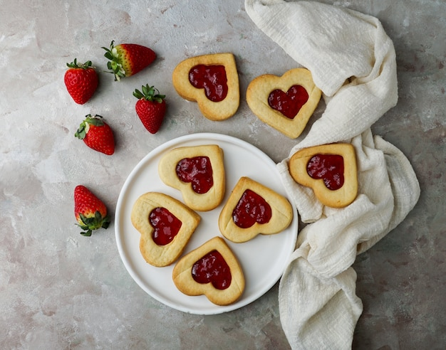 Cookies in the form of hearts with strawberry jam, st. valentine's day consept