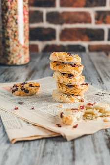 Cookies made from almonds against a brick wall