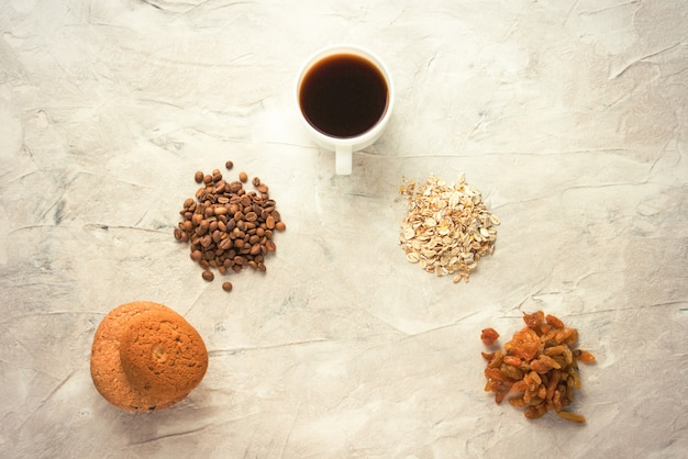 Cookies, oatmeal, coffee, raisins and a cup of tea with milk. concept of the english breakfast