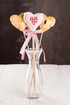 Cookies pops in the form of heart and heart from fabric