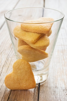 Cookies in the shape of heart in a glass.