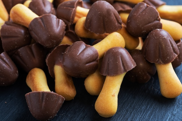 Cookies in the shape of a mushroom, chocolate hat and leg of the test. sweet dessert for children chocolate mushroom.