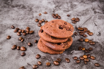 Cookies stack surrounded with roasted coffee beans