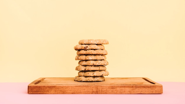 Cookies stack on wooden board on table