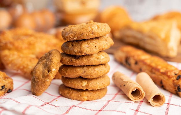 Cookies stacked on a white-red cloth.