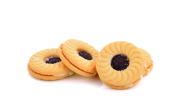 Cookies with blueberry jam on white