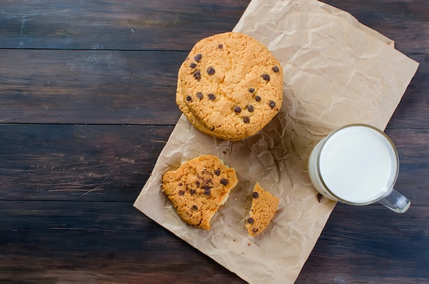 Cookies with chocolate drops and a glass of milk