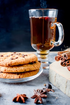 Cookies with chocolate drops, up of  tea, cinnamon, anise