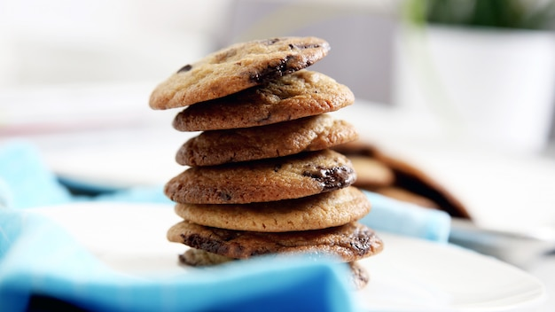 Cookies with chunks of chocolate stand on top of each other
