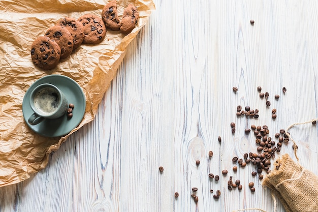 Cookies with coffee set and coffee beans
