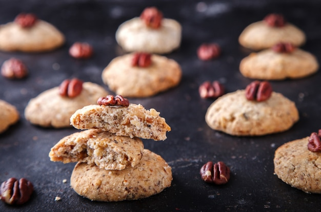 Cookies with a pecan on dark