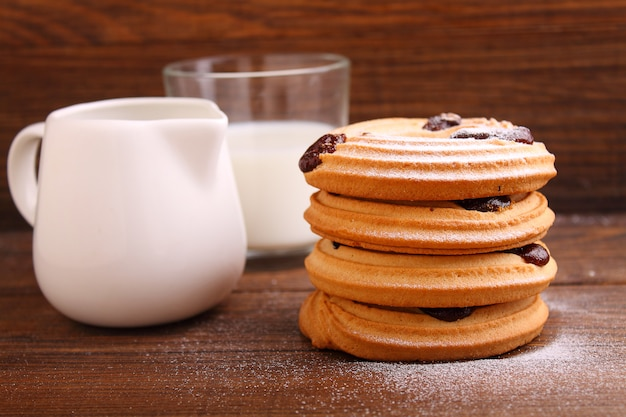 Cookies with powdered sugar on a dark background