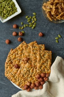 Cookies with pumpkin seeds and nuts, flat lay