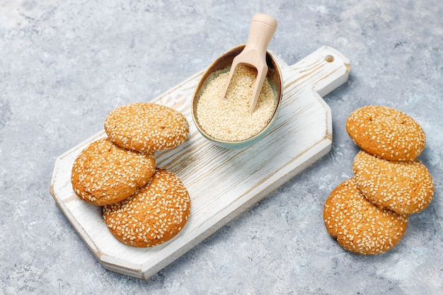 Cookies with sesame seeds on concrete surface,top view