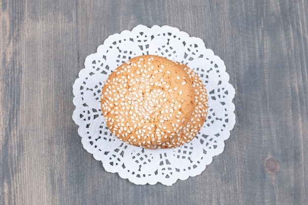 Cookies with sesame seeds on wooden surface