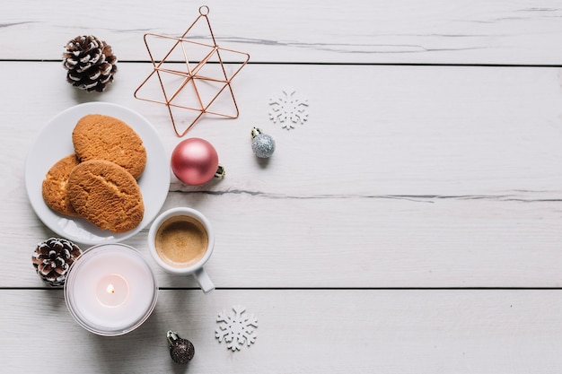 Cookies with shiny baubles on table