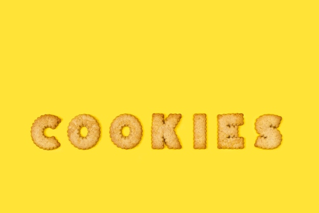 Cookies word write with alphabet letters cookies on a yellow background