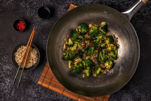 Cooking asian wok with stir fry vegetables