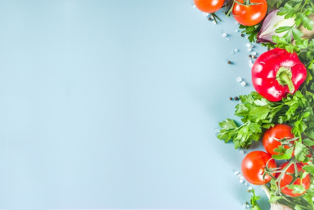 Cooking background with fresh vegetables and herbs