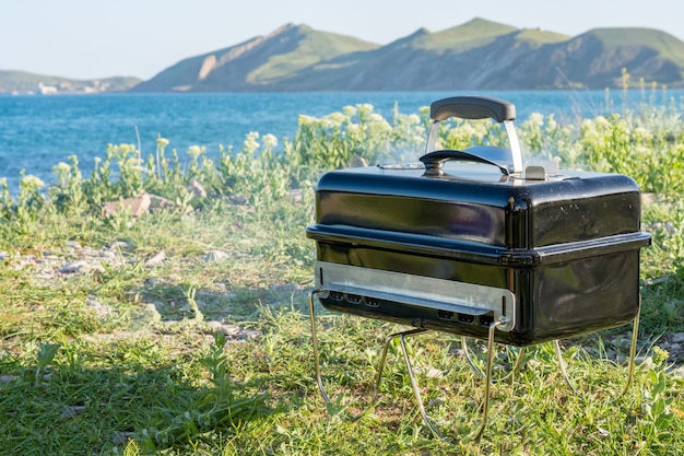 Cooking on the barbecue grill. outdoor. near the sea beach and mountains