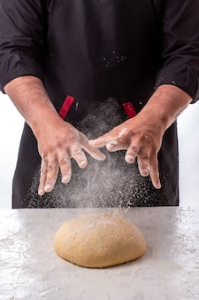 Cooking dough by chef hands for homemade pastry bread, pizza, pasta recipe