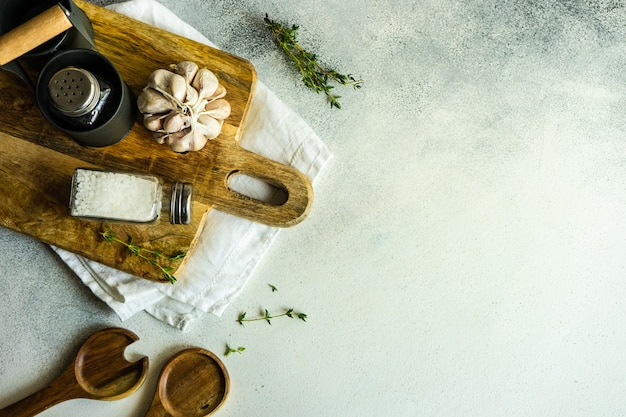 Cooking frame with spices and towel on concrete surface with copy space