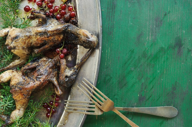 Cooking fried woodcock or snipe in hot butter with red currant.