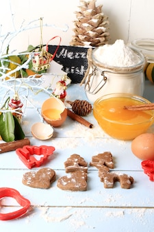 Cooking ginger cookies for christmas homemade cakes on a light wooden background selective soft focus rustic style