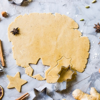Cooking gingerbread cookies from dough using different forms