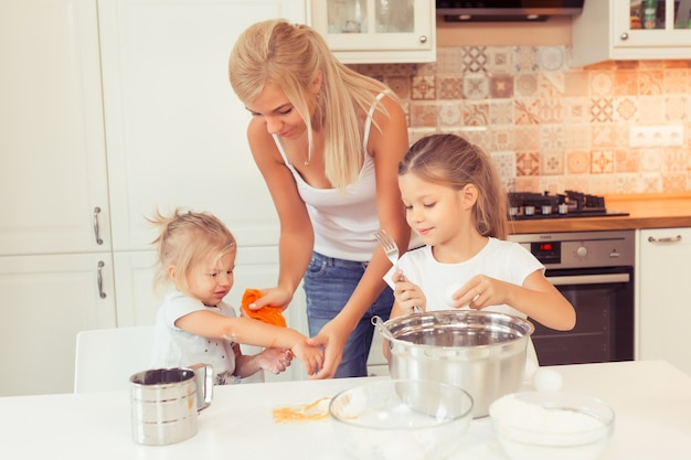 Cooking healthy food at home in the white kitchen
