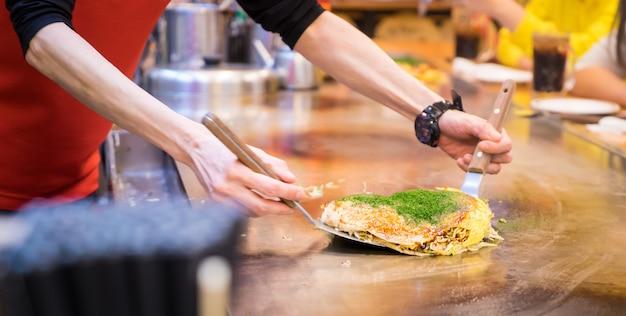 Cooking hiroshima okonomiyaki